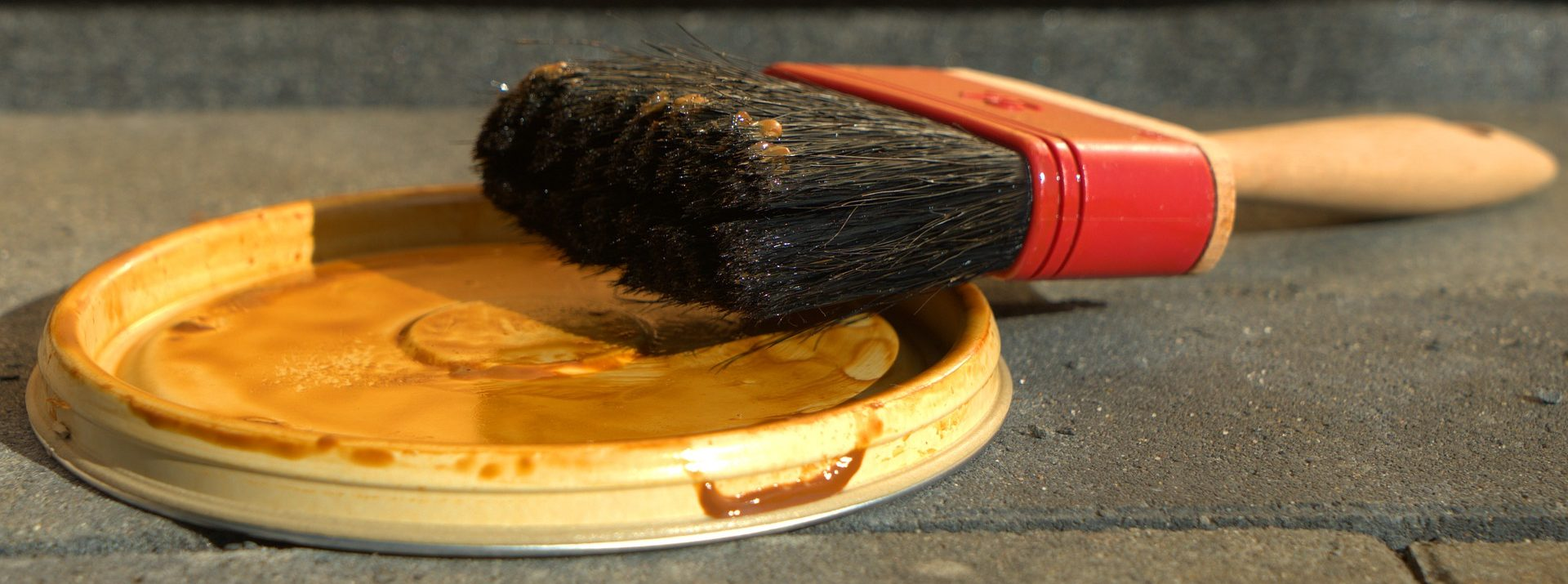 Image of a new homeowners painting brush